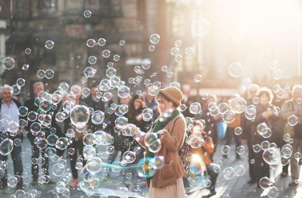 Woman surrounded by bubbles