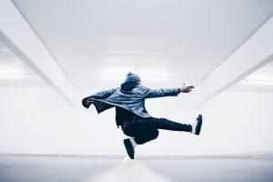 Ninja man in grey/white room